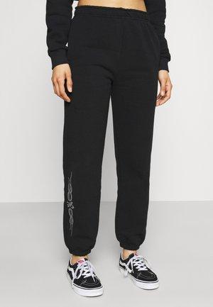 TRIBAL RHINESTONES - Teplákové kalhoty - black