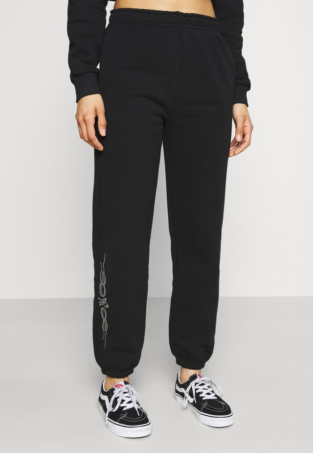 TRIBAL RHINESTONES - Pantaloni sportivi - black