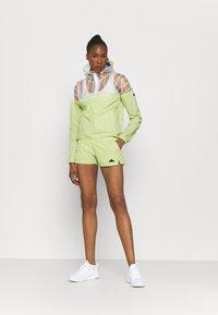Ellesse - OLINA SHORT - Pantalón corto de deporte - light green - 1