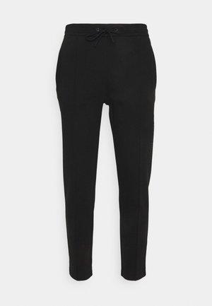 TECHNICAL PANT - Verryttelyhousut - black