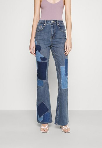RIP AND REPAIR - Flared jeans - mid vintage