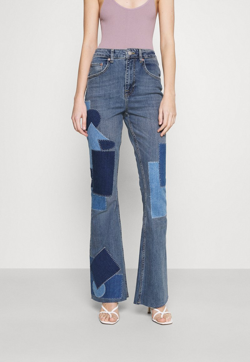 BDG Urban Outfitters - RIP AND REPAIR - Flared jeans - mid vintage