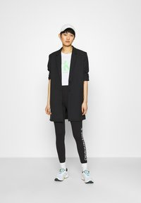 Calvin Klein Jeans - MIRRORED LOGO - Leggings - Trousers - black - 1