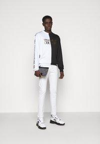 Versace Jeans Couture - DRILL - Straight leg jeans - white - 1