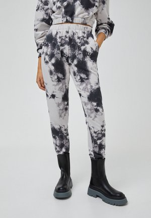MIT TIE-DYE IM KONTRAST - Trousers - light grey