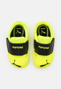 Puma - FUTURE Z 4.1 TT V UNISEX - Astro turf trainers - yellow alert/black/white - 3