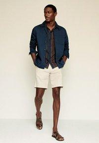Mango - MARTE - Giacca di jeans - dunkles marineblau - 1