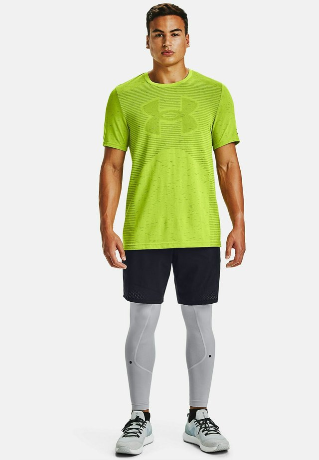 UA SEAMLESS LOGO SS - Sports shirt - green citrine
