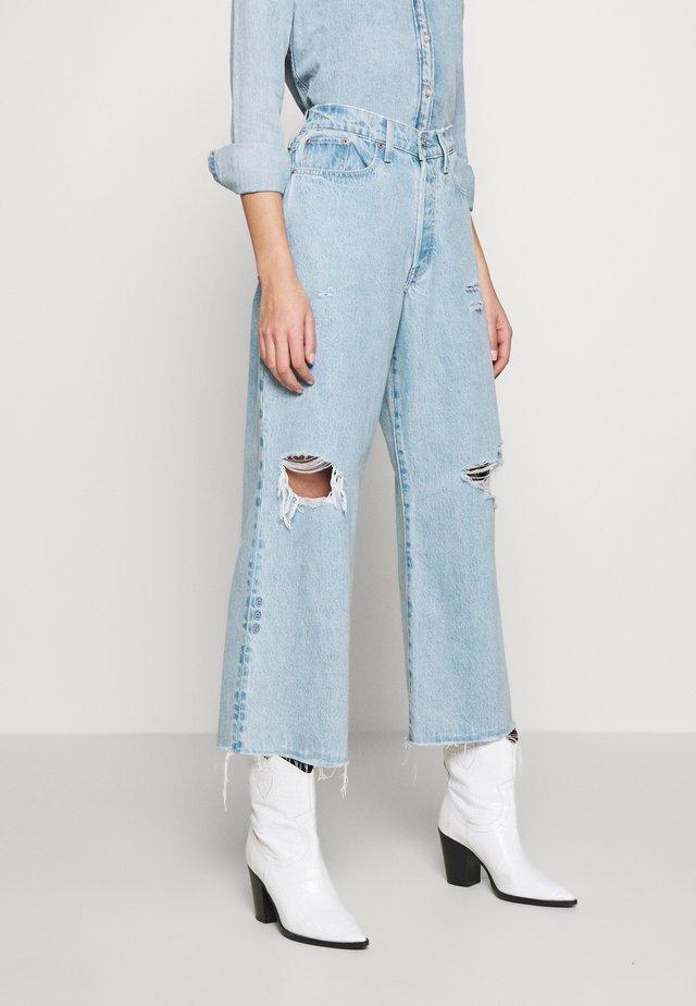 DEVON CROP - Flared jeans - mojave river