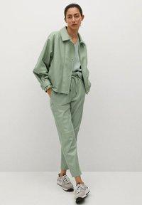 Mango - CREAM - Faux leather jacket - pastellgrün - 1