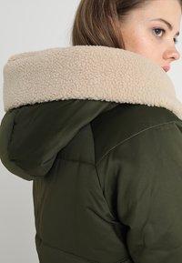 Urban Classics - LADIES SHERPA HOODED JACKET - Winter jacket - dark olive/dark sand - 7