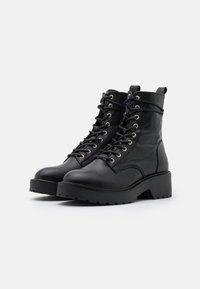 Steve Madden - TORNADO - Lace-up ankle boots - black - 2