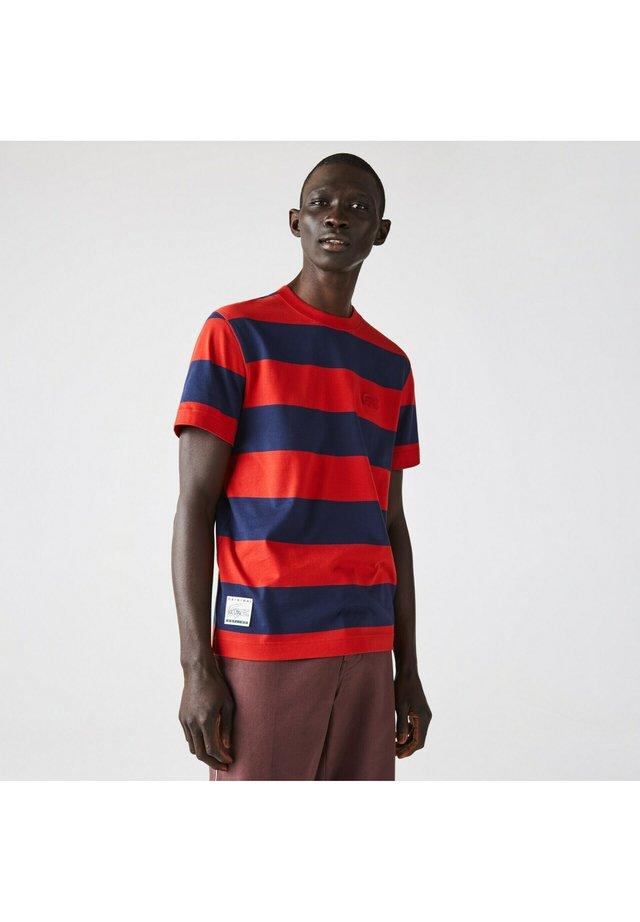 T-shirt imprimé - bleu rouge