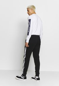 Hollister Co. - Tracksuit bottoms - black - 2