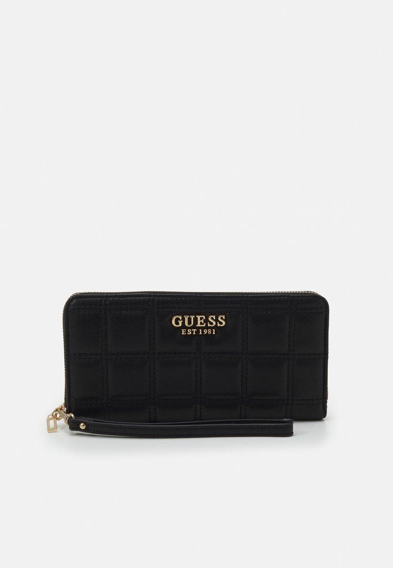 Guess - KAMINA LARGE ZIP AROUND - Wallet - black