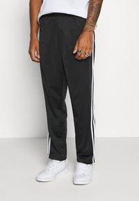 adidas Originals - Tracksuit bottoms - black/white - 0
