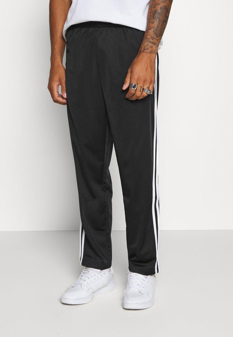 adidas Originals - Tracksuit bottoms - black/white