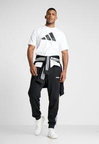adidas Performance - MUST HAVE ATHLETICS SHORT SLEEVE TEE - Print T-shirt - white/black - 1