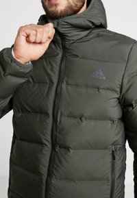 adidas Performance - HELIONIC DOWN JACKET - Chaqueta de invierno - olive - 6