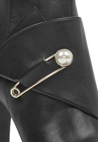 Nine West - High heeled ankle boots - black - 5