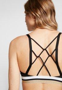Nike Performance - INDY BRA - Sports bra - black/white/metallic gold - 4