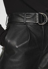 Deadwood - POPPY PANTS - Leather trousers - black - 5