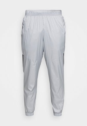 REACTIVE PANT - Tracksuit bottoms - high rise