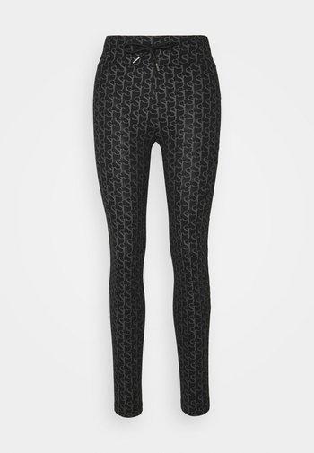MONOGRAM - Leggings - Trousers - black
