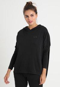 Calvin Klein Underwear - HOODIE - Pyjama top - black - 0