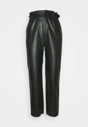 NIKA - Trousers - black