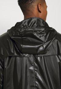 Rains - JACKET UNISEX - Impermeable - shiny black - 4