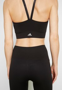 adidas Performance - SEAMLESS BRA - Sports bra - black - 4