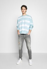 Tigha - MORTEN - Jeans slim fit - mid grey - 1