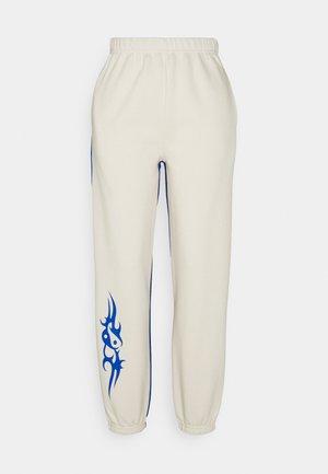 NUDE & BLUE - Tracksuit bottoms - beige