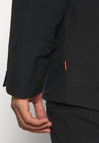 Mammut - ROSEG 3 IN 1 HOODED MEN - Hardshell jacket - black/black - 6