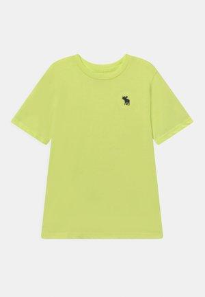 BASICS UPDATE - T-shirts basic - yellow
