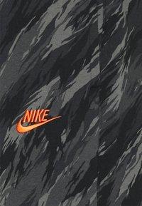 Nike Sportswear - PANT - Tracksuit bottoms - black/orange - 5