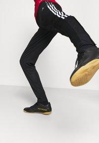adidas Performance - TIRO - Tracksuit bottoms - black/white - 5