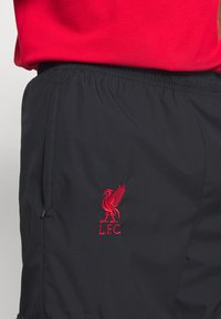 Nike Performance - FC LIVERPOOL PANT - Tracksuit bottoms - black/hyper turquoise/university red - 6
