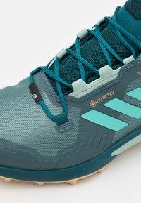 adidas Performance - TERREX SWIFT R3 GORE-TEX MID - Hiking shoes - hazy emerald/acid mint/wild teal - 5