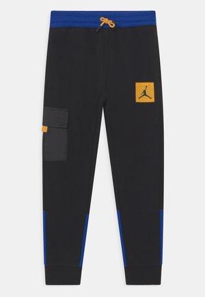 NEXT UTILITY - Pantalones deportivos - black