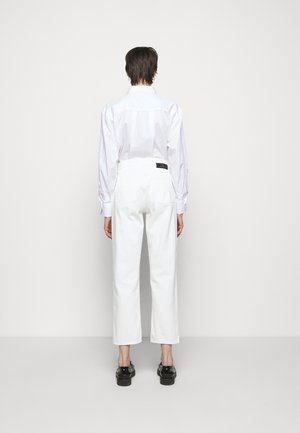 PEARL - Straight leg jeans - tinted white
