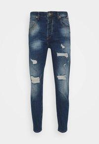 ALEX  - Jeans Tapered Fit - blue denim