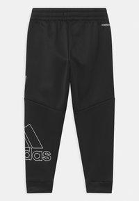 adidas Performance - UNISEX - Tracksuit bottoms - black - 1