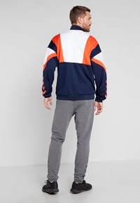 Hummel - RAY - Tracksuit bottoms - dark grey melange - 2