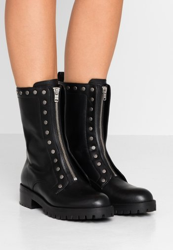 LARA STUDDED COMBAT BOOT