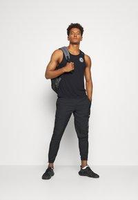 Nike Performance - MILER TANK - Sports shirt - black/sail/silver - 1