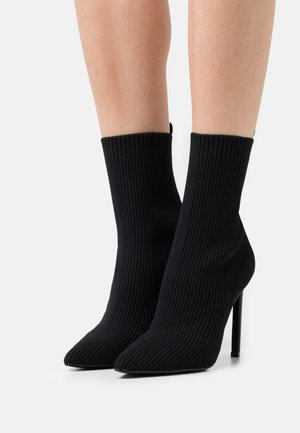 DOLER - Classic ankle boots - black