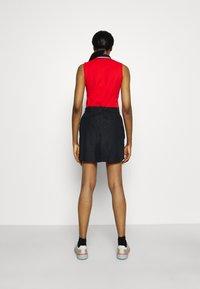 Under Armour - LINKS PRINTED SKORT - Sports skirt - black - 2