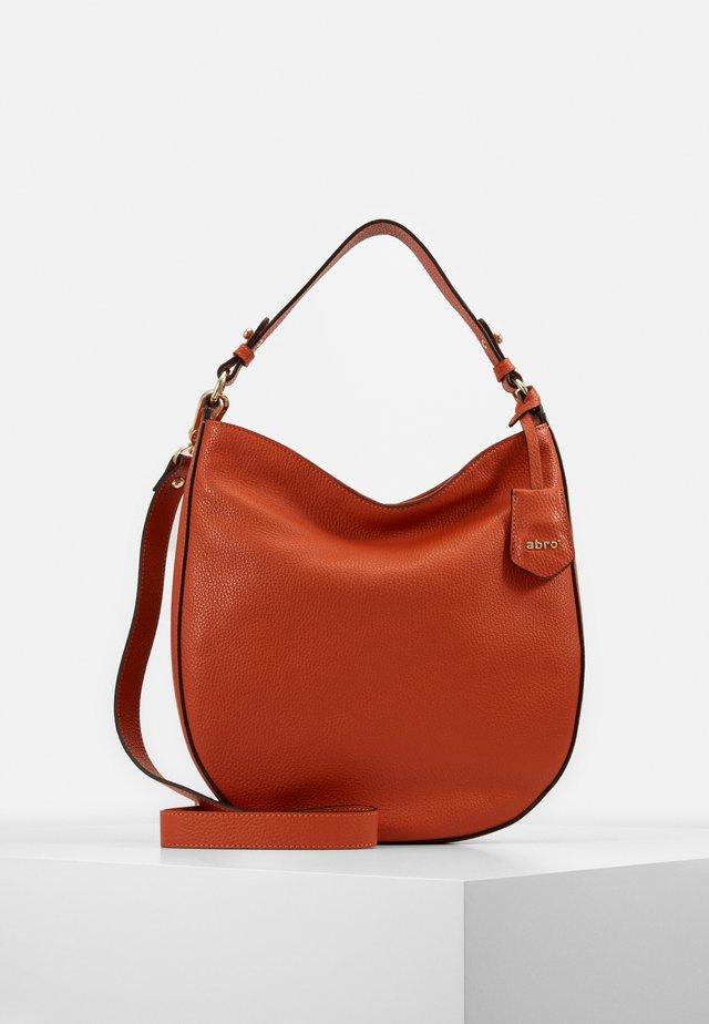 Käsilaukku - orange